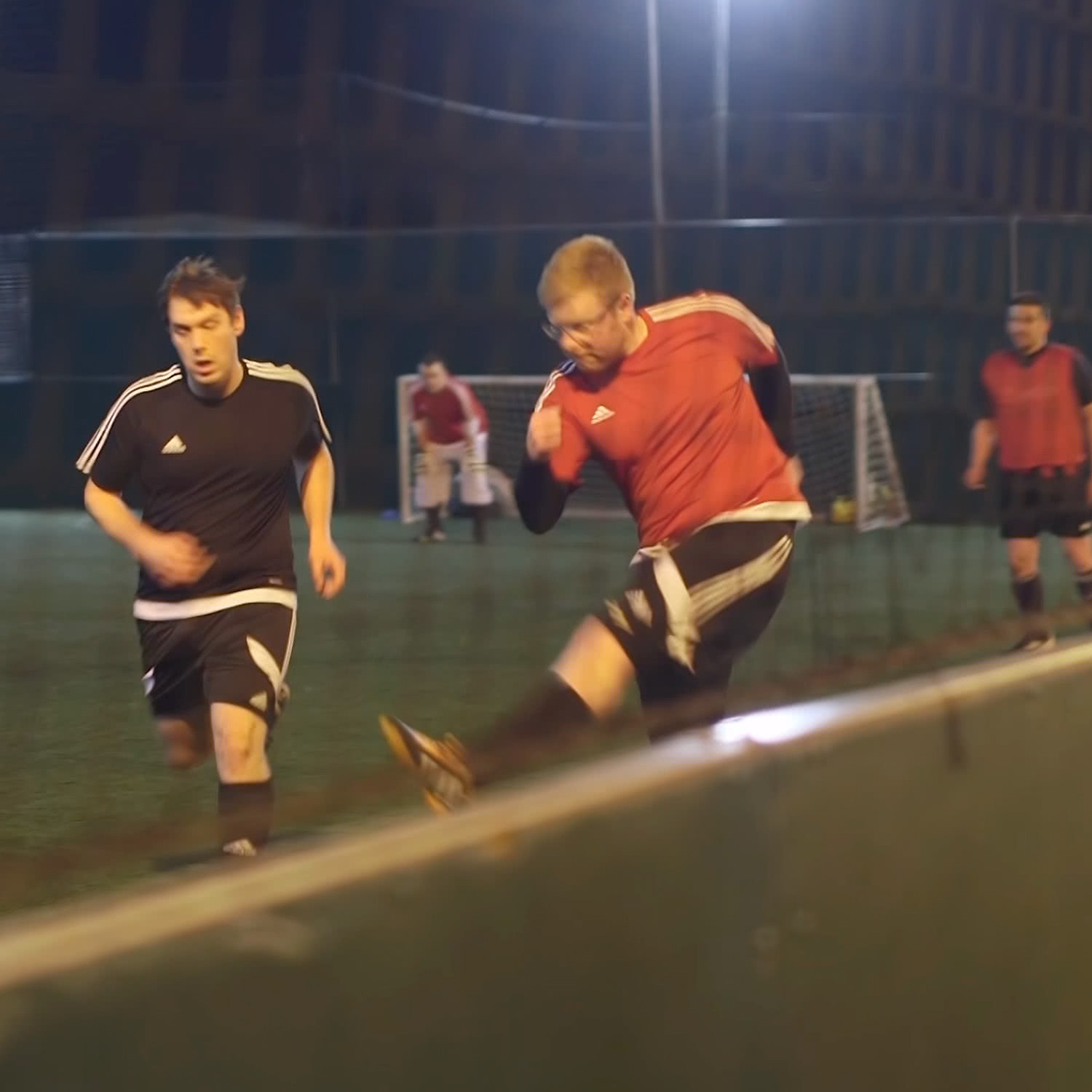 Men playing football at MAN V FAT